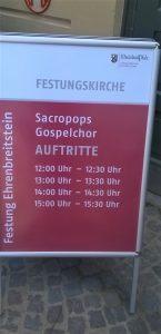 Plakat mit Auftrittszeiten